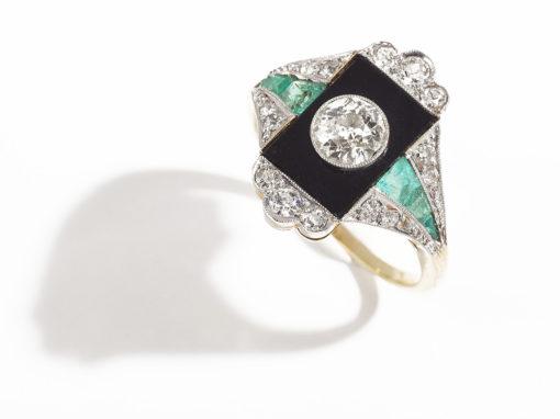 Bague Art déco diamant central et émeraudes